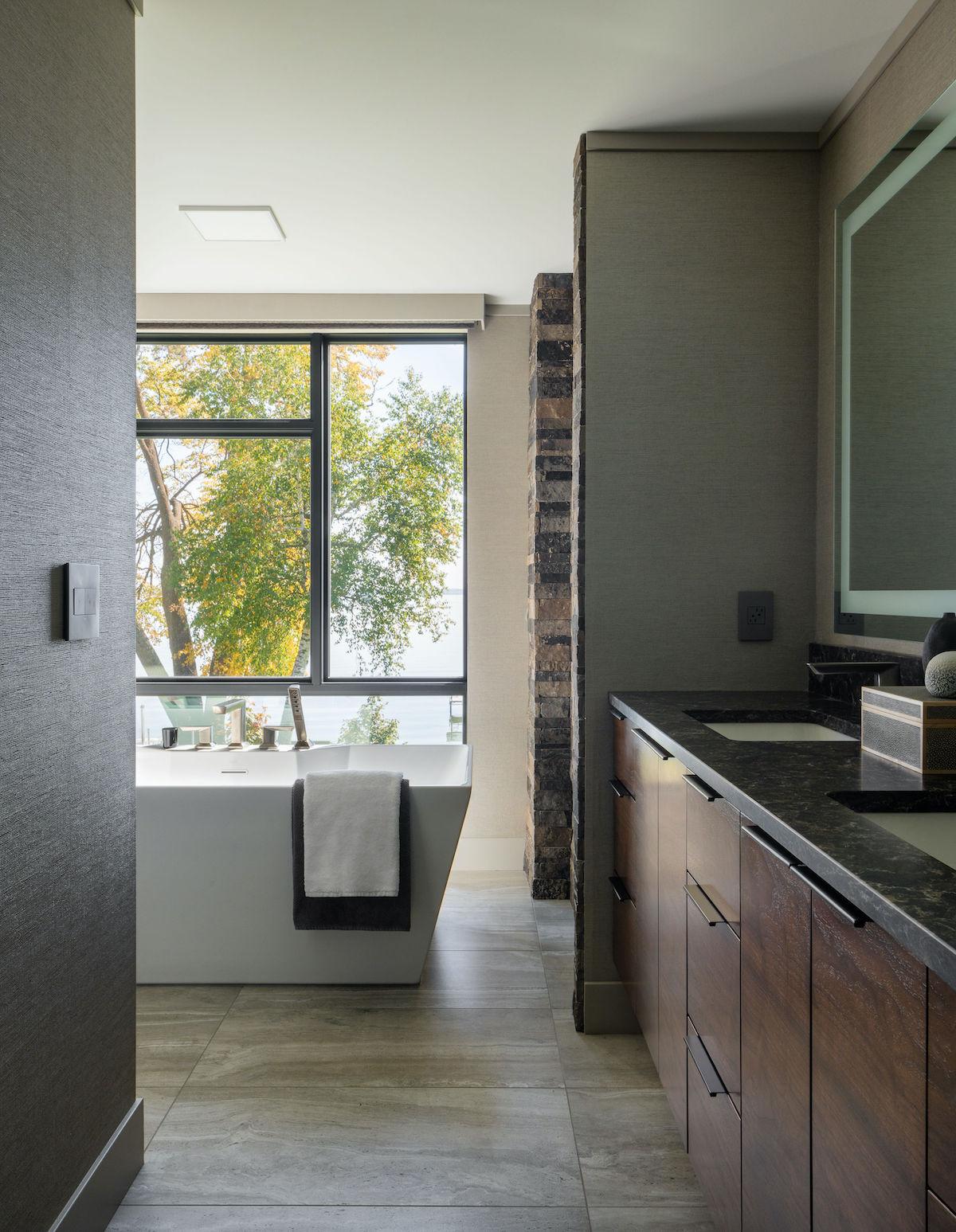 bathroom with tub by windows