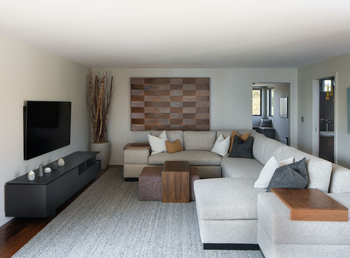 room with sectional sofa and wood accents