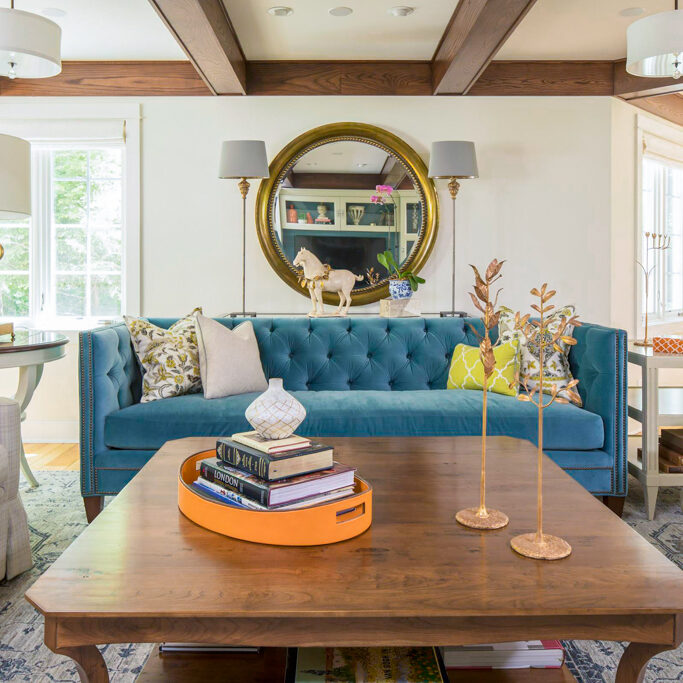 blue tufted couch in living room